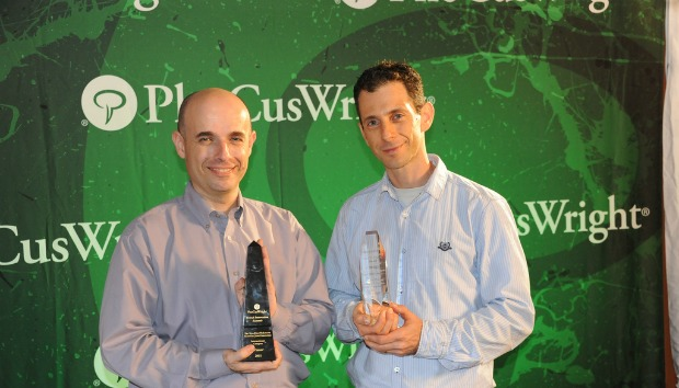 Evature's Barry Volinskey, left, and Tal Weiss receiving the DEMO award for the most game changing travel innovation at the PhoCusWright 2011 Travel Industry Summit.