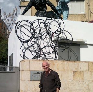 Polak outside his Givatayim studio, where he also gives historic tours and exhibits works of other artists. Photo by Abigail Klein Leichman