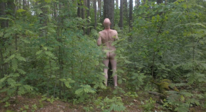Polak in the Riga forest where his grandmother was killed by the Nazis.