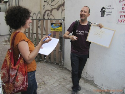 Guy Sharett explaining Israeli street art. Photo by Deborah Sinai