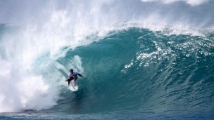 Surfers head to Hawaii to catch the big waves. (Shutterstock.com)