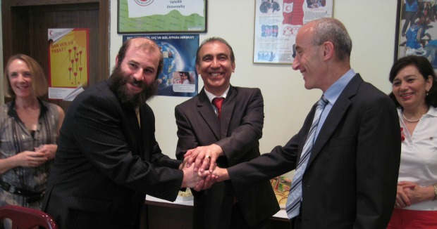 From left, Tag International Development founder Rabbi Yossi Ives, Vice President Gafar Asgarzade of the Azerbaijan Red Crescent Society and then-Israeli Ambassador Michael Lotem.