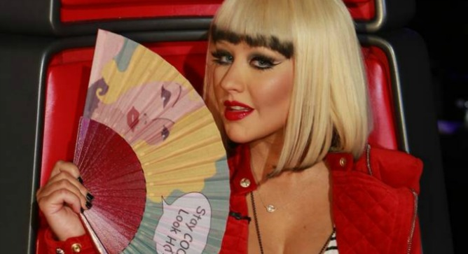 Christina Aguilera loves Fancy Hand Fans. Photo courtesy of Christina Aguilera's FB page by Trae Patton/NBC