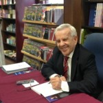 Dr. Eli Fischer signing copies of his autobiography at Barnes & Noble Bookstore at the University of Chicago.