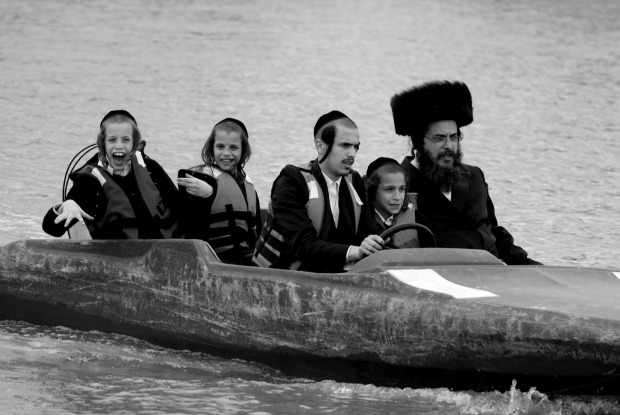 """Charedim on a speedboat"" by Steven Winston"