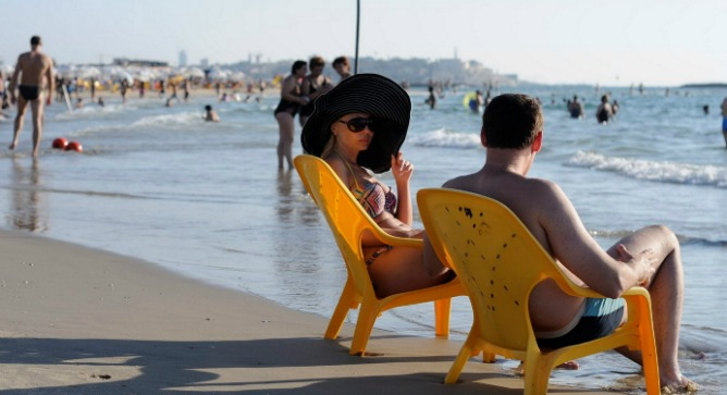 Relaxing on the beach in Tel Aviv. Photo by Flash90.