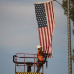 A Jerusalem municipality worker hangs an American flag near the President's House in Jerusalem on March 12 in preparation for the upcoming visit of US President Barack Obama. Photo by Yonatan Sindel/Flash90