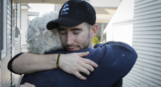 A member of IsraAid helping out local residents in the wake of Hurricane Sandy. Photo courtesy of IsraAID.