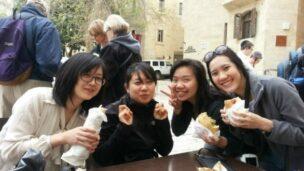 IIP students Shih-Why Lin, Meiling Liu,Myrna Handoko and Tar Naruporn Ananpongsuk having a taste of shwarma and falafel during their trip to Israel.