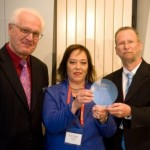 Dr. Peter Harrop, Chairman of IDTechEx, presents an award to Sol Chip CEO Dr. Shani Keysar and Rami Friedlander, VP Business Development & Applications.