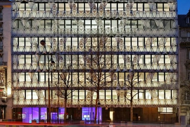 "Manuelle Gautrand Architecture dressed up the façade of the French headquarters of Barclays bank in what looks like a random series of folded ""pages"" of marble using the medium of digitally printed glass with ceramic ink."