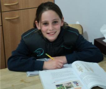 Kids can even wear BioHug comfortably while doing homework.