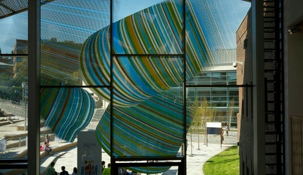 Artist Alexander Beleschenko won a competition with this multi-colored printed glass design for the Forum, University of Exeter, UK. Dip-Tech digital in-glass printing with ceramic inks was the only solution capable of meeting the challenges posed by so many colors integrated in an external application.