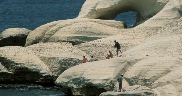 Claiming rocks at Rosh Hanikra. Photo by Flash90.