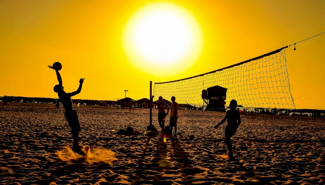 Beach volleyball courts are open into the night in Herzliya. Photo by Ohr Mani