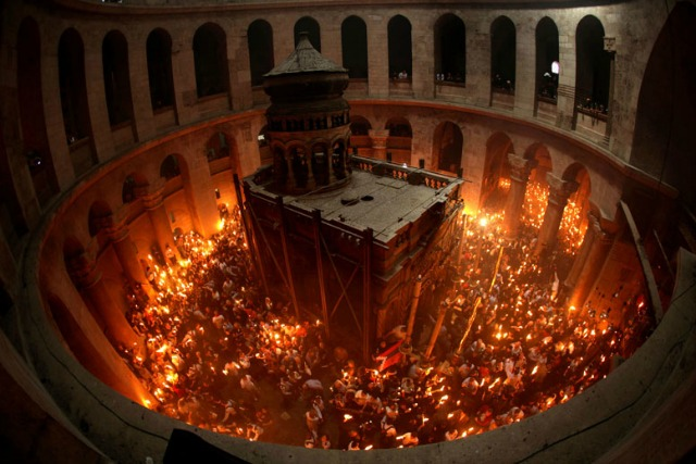 Christian Orthodox worshippers celebrating Easter at the Church of the Holy Sepulcher in Jerusalem. Photo by Gali Tibbon