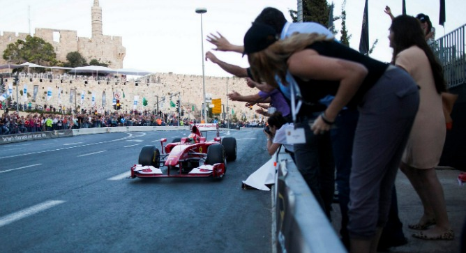 A Formula One driver zooms past Jerusalem's historic Tower of David. Photo by Flash90.