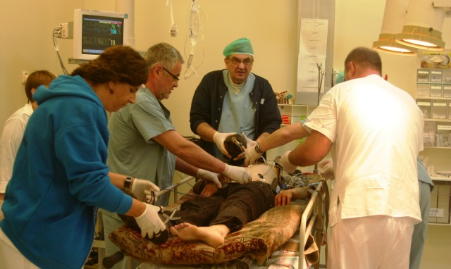 Israeli personnel treating a Syrian.