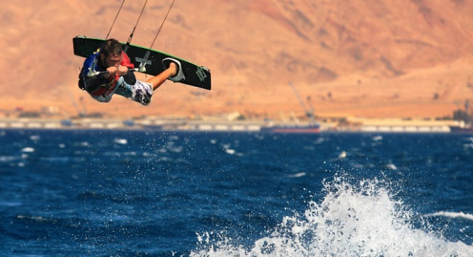Kitesurfing in Eilat. Photo by Rostislav Glinsky/Shutterstock.com.