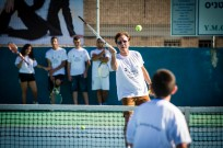 Sir Cliff Richard plays tennis with Arab and Jewish youth at the Nazareth Tennis School. (David Katz)