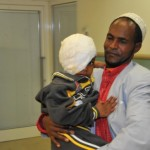 Abdulrazak and his father at the Israeli hospital. Photo by Rony Albert