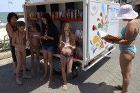 No need to stain your favorite book with sunscreen splotches, the city has you covered with its new beach library. (Malovani Israel)