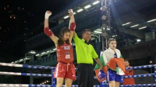 Nili Block claiming the Thai boxing title in Thailand.