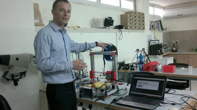 Reut Institute CEO Roy Keidar in the 3D printing lab. Photo by Abigail Klein Leichman