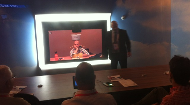 TelePresence creates a virtual conference room.