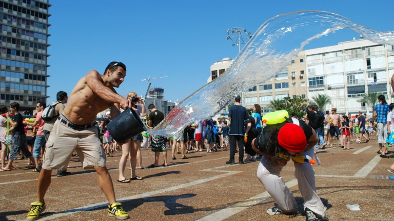 Splashing fun at Rabin Square in Tel Aviv. (photo courtesy of Water War TLV's Facebook page)