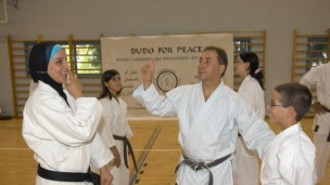 Peace with a kick to it. Danny Hakim with students at Budo for Peace.