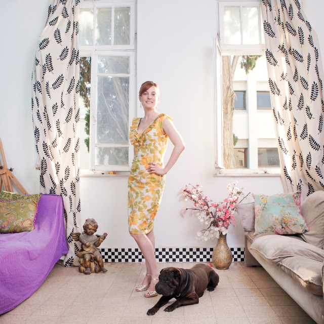 Woman in flower dress with dog