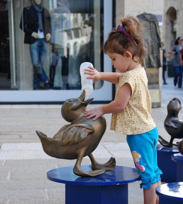 Girl nursing duck