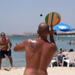 Matkot on the beach – Israel's summer obsession. Photo by Flash90.
