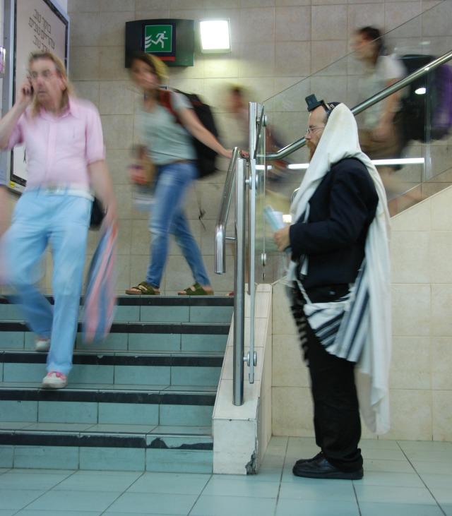 Praying in train station