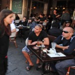People watching on Tel Aviv's most famous street. Image via ChameleonsEye / Shutterstock.com.