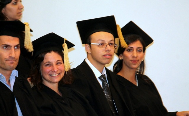 The valedictorian is seated at far right.