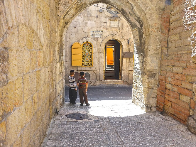 Two boys waiting in Jerusalem
