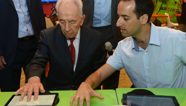 Co-inventor Nissan Yaron demonstrating UpSense keyboard for the blind. Photo by Mark Neiman/GPO