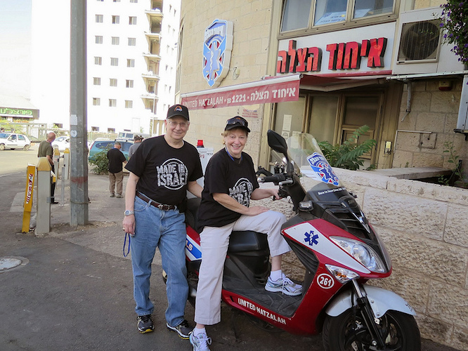 Steven and Karen Ostrove check out an ambucycle outside United Hatzalah headquarters in Jerusalem