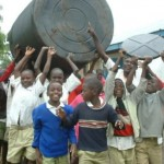 Children in Kenya helping to install an Israeli system for collecting rainwater from the roofs of schools.