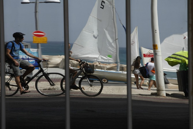 Bicycling on the Tel Aviv promenade.