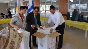 Philippine Ambassador to Israel Generoso D. G. Calonge joined Israeli youth at the Boys Town Jerusalem school to pack aid for his typhoon stricken country. (Courtesy)
