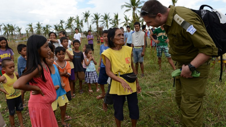 The IDF giving aid in the Philippines in the wake of  the Typhoon. Photo courtesy of IDF