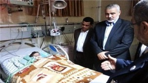 Ismail Haniyeh visits his granddaughter in a Gazan hospital. (Social media networks)