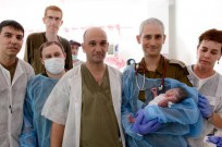 Israeli doctors with first Philippine baby born in field hospital. (IDF Spokesperson)
