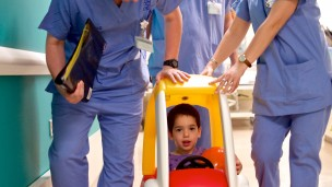 Three-year-old Shachaf Rosenbloom was one of the first young patients at the Schneider Children's Medical Center to try out the new pedal car transfer service.  (Courtesy)