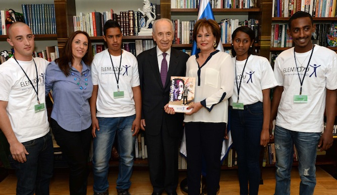 Israeli President Shimon Peres with Nava Barak, president of the ELEM, as Peres receives the annual ELEM report. Photo by  Kobi Gideon/FLASH90