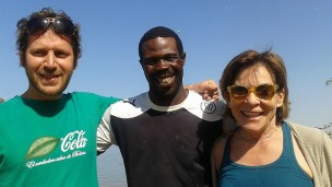 Amit Savaia, left, with Elizabeth Huttinger from Project Crevette and Badjie, a local fisherman who supplies the prawns.