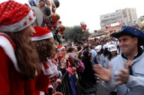 Waiting for the Christmas parade in Nazareth. Photo by Flash90.
